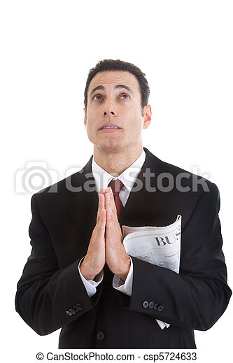 Businessman Holding Business Section Newspaper Looking Up Praying - csp5724633