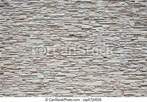 Full Frame Stone Wall  Tightly Stacked Sandstone Slabs - csp5724935