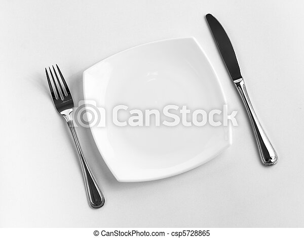 Place setting for one person. Knife, square white plate and fork. - csp5728865