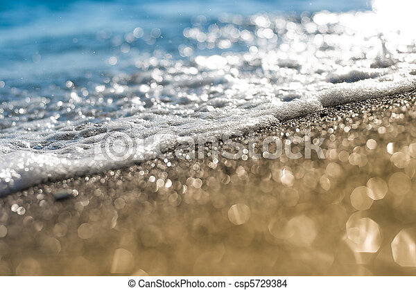 Sand beach and sea foam macro with narrow focus background - csp5729384