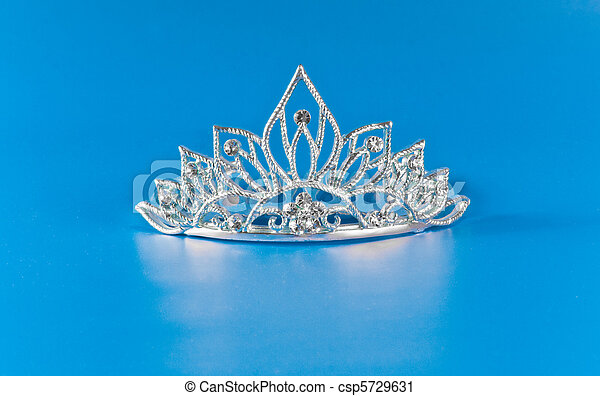 Tiara or diadem with reflection on blue background - csp5729631
