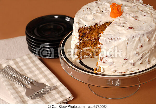 Whole carrot cake with cream cheese and pecan frosting - csp5730084