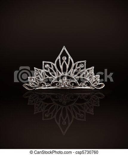 Tiara or diadem with reflection on dark background - csp5730760