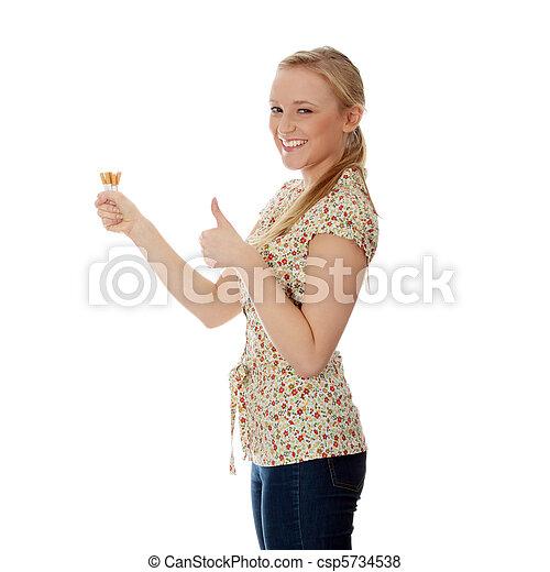 Young caucasian woman quiting smoking  - csp5734538