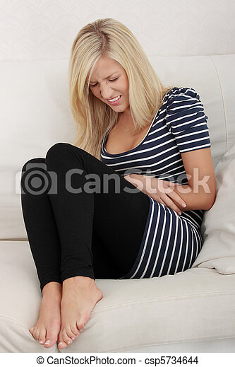 Blond woman with stomache issues - csp5734644