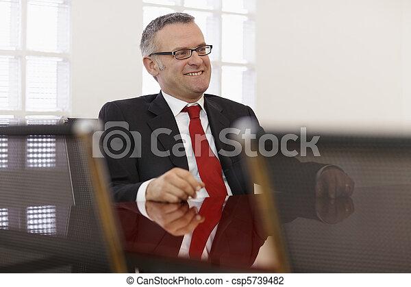 Businessman in corporate meeting - csp5739482