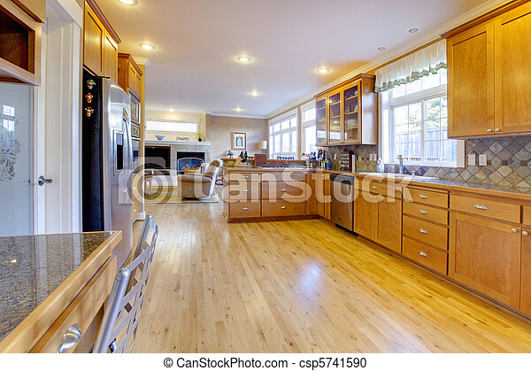 Maple wood cabinets in a large kitchen. - csp5741590