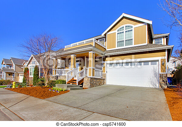 Happy yellow new house exterior photo during spring - csp5741600