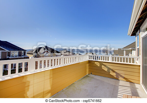 Balcony of the yellow house with water view - csp5741662