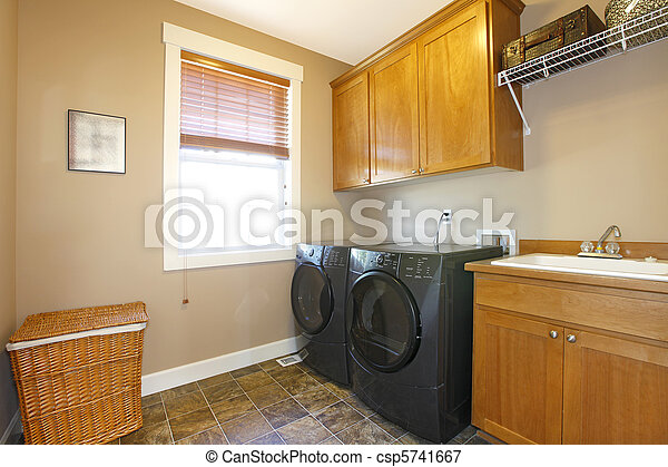Laundry room with black appliances and nice cabinets - csp5741667