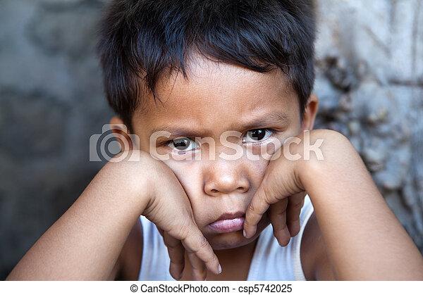 Young Filipino boy - poverty - csp5742025