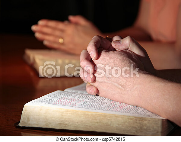 Man and Woman Praying with Bibles - csp5742815