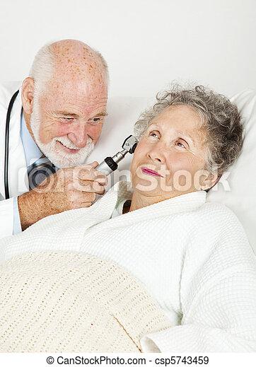 Doctor Examines Hospital Patient - csp5743459