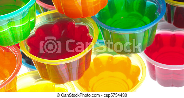 Colorful jellies in plastic bowls arranged in a pile and photographed from above (Selective Focus, Focus on the rim of the left red jelly)  - csp5754430