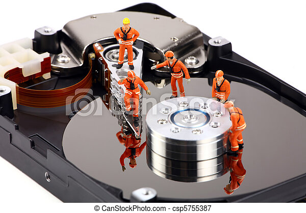 Miniature technicians work on hard drive - csp5755387