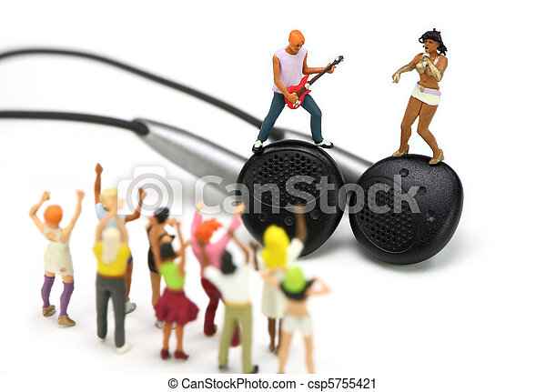Miniature singer and guitar player standing on a pair of ear buds - csp5755421
