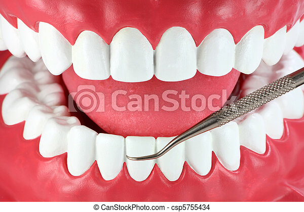 Mouth with white teeth and dental pick tool - csp5755434