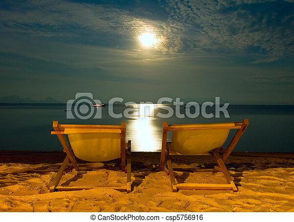 beach chairs at tropical resort - night scene - csp5756916