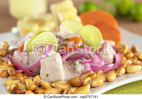 Peruvian-style ceviche made out of raw mahi-mahi fish (Spanish: perico), red onions, limes and aji (Peruvian hot pepper) and served with roasted corn (cancha) and cooked corn cob as well as cooked swe - csp5757141