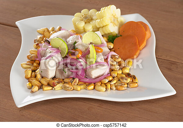 Peruvian-style ceviche made out of raw mahi-mahi fish (Spanish: perico), red onions, limes and aji (Peruvian hot pepper) and served with roasted corn (cancha) and cooked corn cob as well as cooked swe - csp5757142