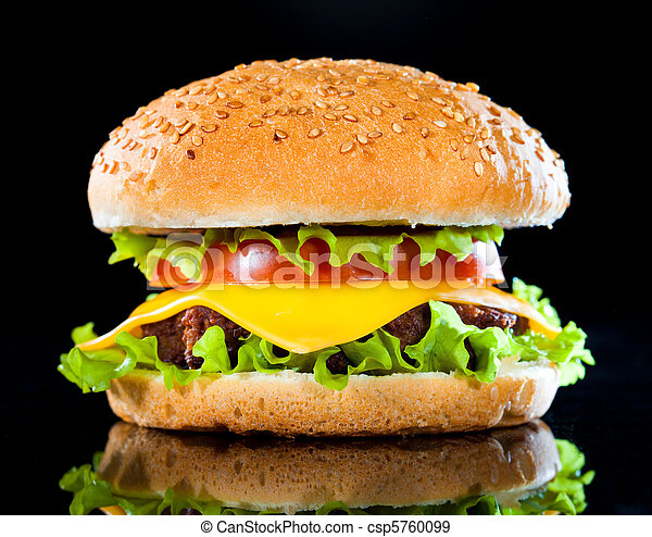 Tasty and appetizing hamburger on a dark - csp5760099