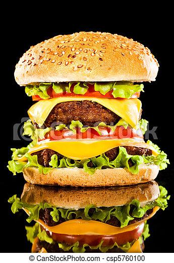 Tasty and appetizing hamburger on a dark - csp5760100