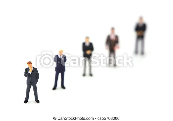 Miniature businessmen standing in a row diagonally - csp5763006