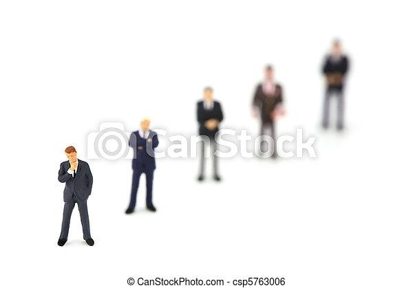 Miniature businessmen standing in a row diagonally - csp5763006