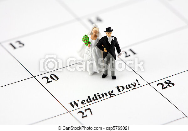 Concept: Bride and groom on calendar - csp5763021