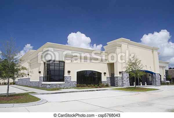 beige stucco with gray brick retail store - csp5768043