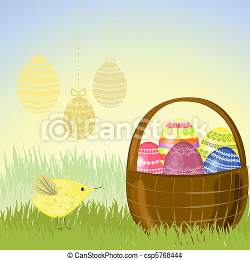 Basket of Easter eggs in the meadow - csp5768444