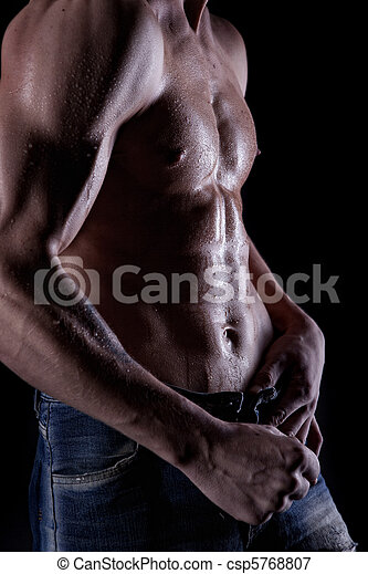 Posing muscular naked man with body in water drops on black - csp5768807