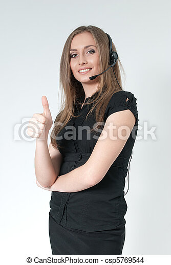 Happy smiling attractive call center operator. Sexy girl wearing headset. Showing big finger super sign. One of a series. - csp5769544