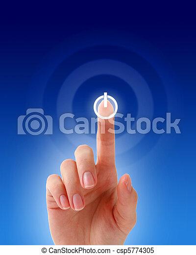 Hand pressing a button. - csp5774305