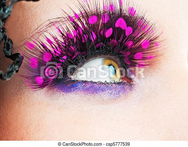 Woman eyes with stylish eyelashes - csp5777539