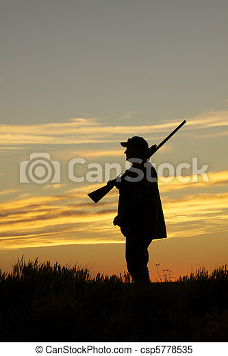 Upland Game Hunter at Sunset - csp5778535