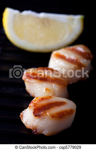 closeup of two grilled scallops - csp5779029