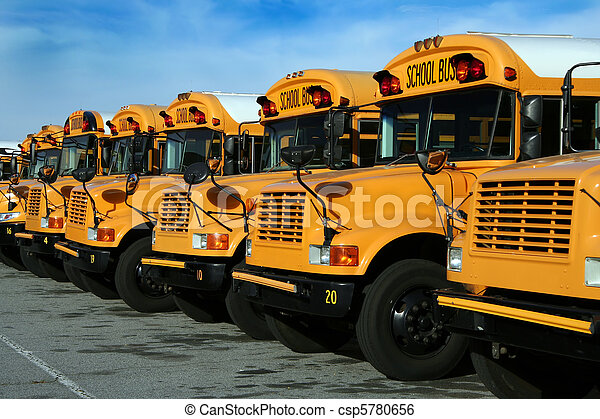 Row of parked public school buses - csp5780656