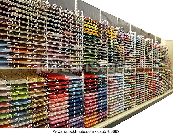 Colorful craft or scrapbook paper on shelves - Isolated - csp5780689