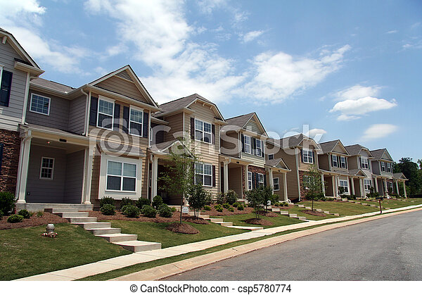A row of new townhomes or condominiums - csp5780774