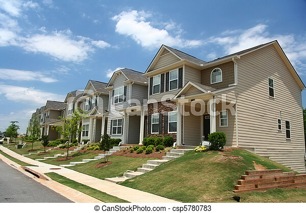 A row of new townhomes or condominiums - csp5780783