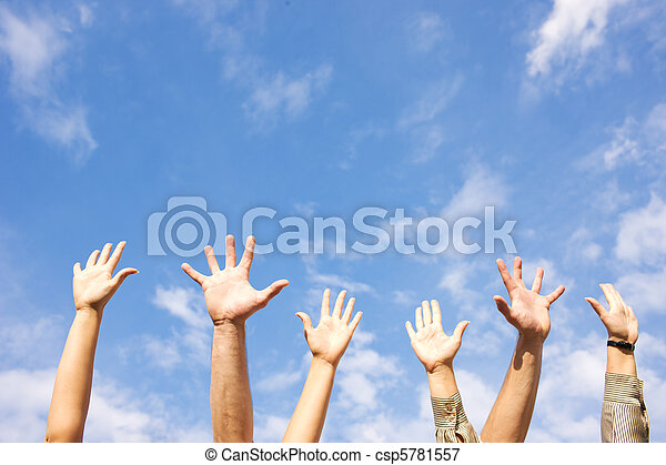 Hands rised up in air across  sky - csp5781557