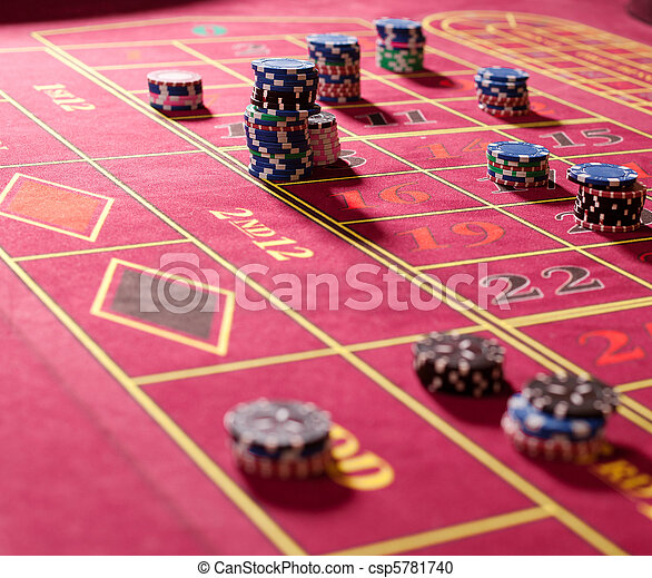 Gambling chips on red roulette table - csp5781740