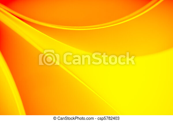 background macro image of a pattern made of curved sheets of paper in yellow and orange colour tones. - csp5782403
