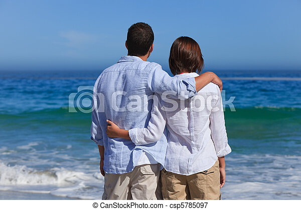 Enamored couple looking at the sea - csp5785097