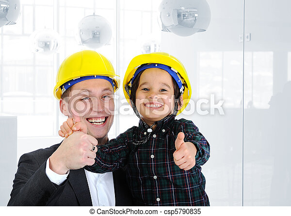 Happy boss and employee together, father and son engineers on work playing - csp5790835