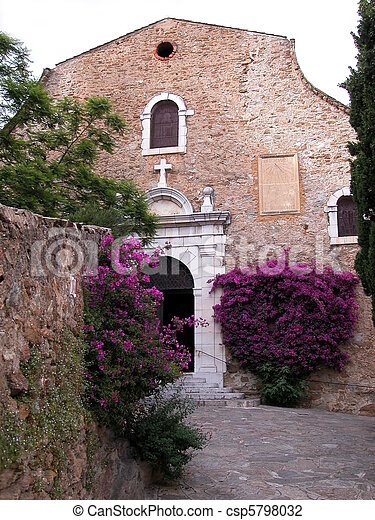 Church facade with bougainvillea flowers - csp5798032