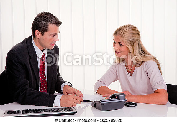 Woman signs a contract in an office - csp5799028
