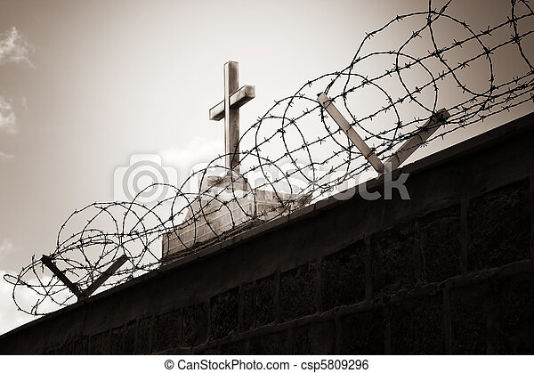 Religion and war - cross behind barbed wire - csp5809296
