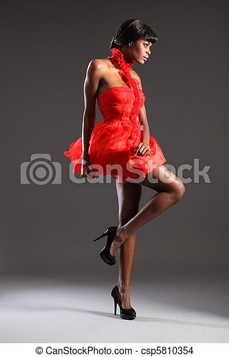 Sexy fashion model in red dress - csp5810354